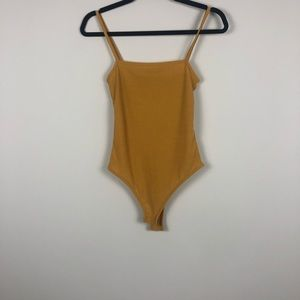 Prettylittlething mustard color bodysuit tank top